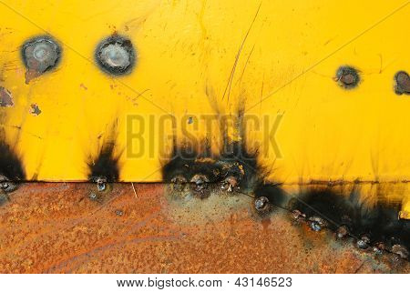Burn After Welding On The Old Metal Plate Background