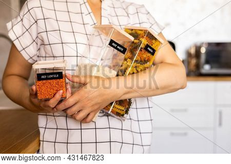 Closeup Housewife Posing With Marking Sticker Names Titles Of Bulk Products On Plastic Case Box