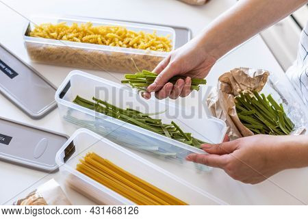 Top View Female Housewife Placing Sorting Different Kinds Of Vegan Pasta Into Pp Boxes