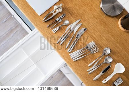 Top View Closeup Housewife Hands Tidying Up Cutlery In Drawer General Cleaning At Kitchen