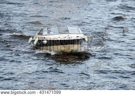 Russia, St. Petersburg, June 2021: A Pleasure Boat Sails On The Neva River
