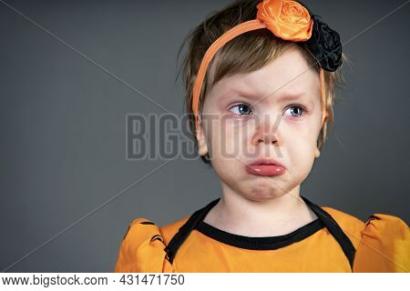 Offended Little Girl. Close-up Face Of A Child, Emotion Sad Of Crying Children In Tears, In The Stud