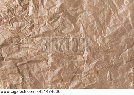 Crumpled Craft Brown Paper Background. Abstract Recycled Craft Paper Texture.
