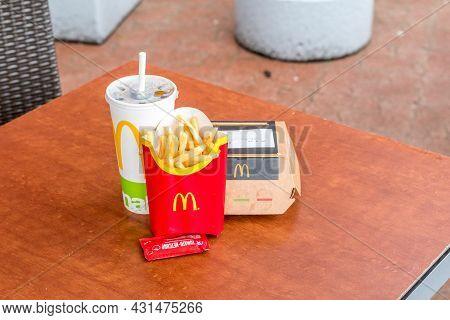 Zilina, Slovakia - June 5, 2021: Mcdonald's Menu With French Fries, Coca-cola And 1955 Burger.
