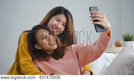 Beautiful Young Asian Women Lgbt Lesbian Happy Couple Sitting On Sofa Hug And Using Phone Taking Sel