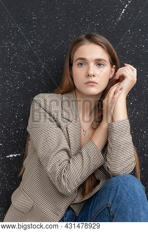 Portrait Of Young Attractive Caucasian Woman With Long Hair, Blue Eyes In Suit Jacket. Skinny Pretty
