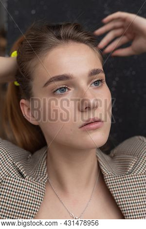 Closeup Portrait Of Young Attractive Caucasian Woman With Blue Eyes In Suit Jacket. Skinny Pretty La