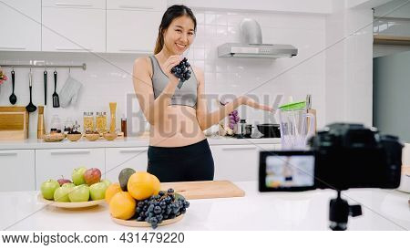 Blogger Sporty Asian Woman Using Camera Recording How To Make Grape Juice Video For Her Subscriber,
