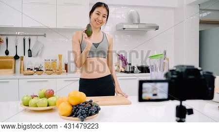 Blogger Sporty Asian Woman Using Camera Recording How To Make Avocado Juice Video For Her Subscriber