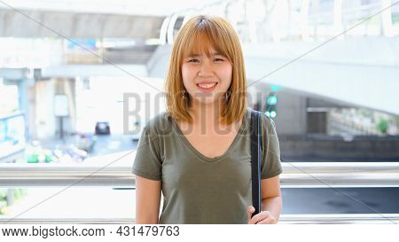 Attractive Young Smiling Asian Woman Outdoors Portrait In The City Real People Series. Outdoors Life