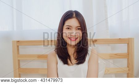 Teenager Asian Woman Feeling Happy Smiling And Looking To Camera While Relax In Bedroom At Home. Lif