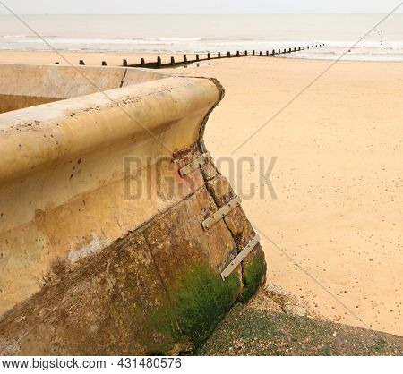 Metal Strapping Attached To Sea Wall To Prevent Coastal Erosion