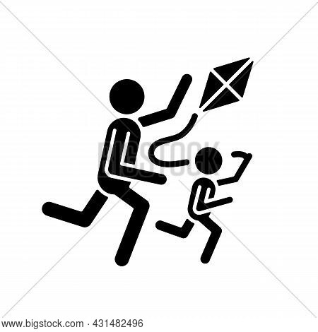 Flying Kite Black Glyph Icon. Playing With Child Outdoors. Family Bonding Opportunity. Develop Coord