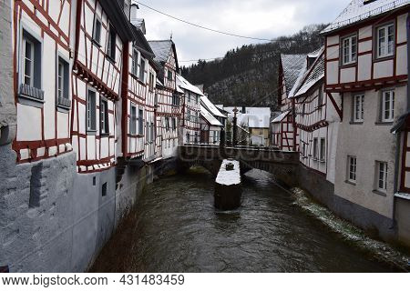 Elz River In Monreal With Half Timbered Houses And The Bridge