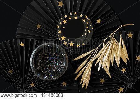 Cosmetic Star Glitter Face Mask On Black Background With Gold Decor. Purifying And Moisturizing Mask