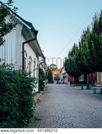 Small Street In A Small Town With Trees And Houses