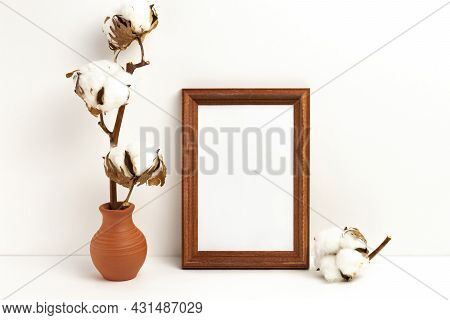 Mockup Photo Frame And Vase With Dried Branch Of Cotton. Empty Photo Frame Mockup To Showcase Your A