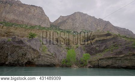 Swimming On Mountain River With Rocky Cliffs. Action. Sailing On Motor Boat On Mountain River With V