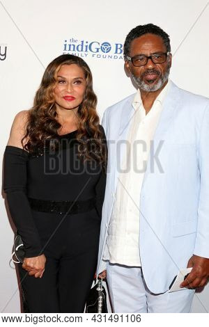 LOS ANGELES - AUG 20:  Tina Knowles-Lawson, Richard Lawson at the 21st Annual Harold and Carole Pump Foundation Gala at the Beverly Hilton Hotel on August 20, 2021 in Beverly Hills, CA