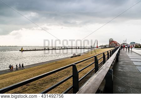 Bremerhaven, Germany - August 6 2019: Promenade In The Port Of Bremerhaven A Stormy Day Of Summer At