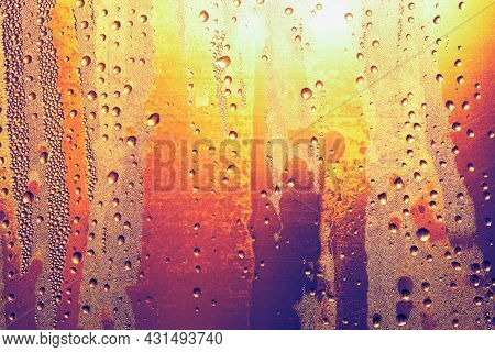 Condensation On The Beer Bottle . Water Drops On The Glass . Cold Drink