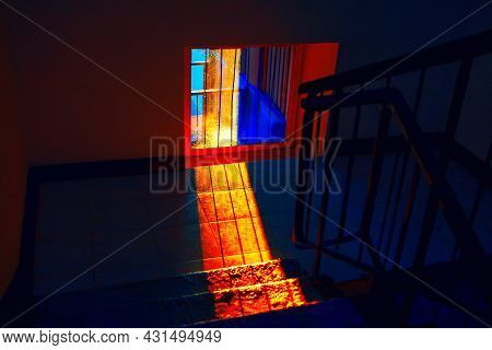 Dark Room With Sunlight In Window . Interior With Stairs And Dim Light