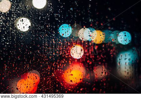 Night City Lights, Traffic In The Rain, Bad Weather, Abstract Defocus Background, Bokeh Effect.