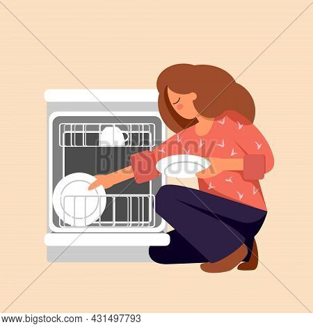 The Girl Puts The Plate In The Dishwasher. Young Woman Takes Out Clean Dishes. Concept For Housework