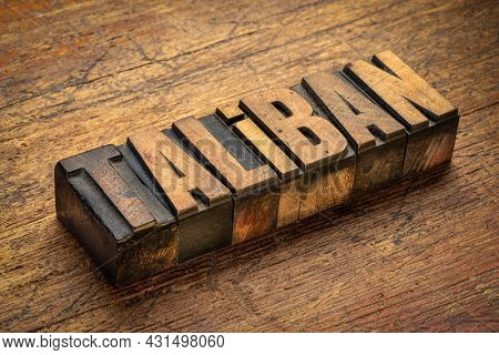 taliban word abstract in vintage letterpress wood type against grunge wood,  Afghanistan