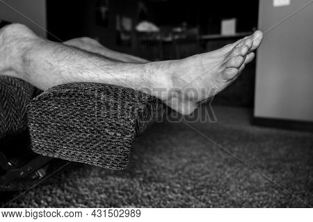 White Caucasian Male With Feet Elevated On Reclining Chair