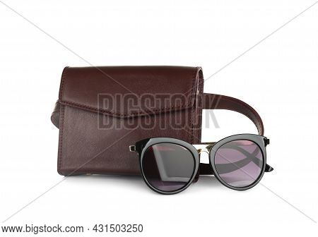 Brown Women's Leather Flap Bag And Sunglasses On White Background