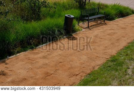 Sand Wheeling. Garden Wheelbarrow Carries A Worker And Pours On Piles Of Beige Gravel To Repair Park