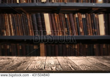 Empty Wooden Table In Library. Space For Design