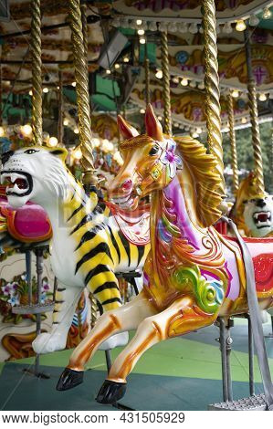 London, U.k., July 22,2021: Carousel Horse, Having Fun, Merry Go Ride At London Zoopark