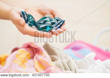 Person Showing Washing Machine Laundry Pods Capsules Detergent, Household Duties Chemicals Objects.
