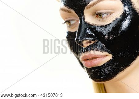 Girl Black Carbo Peel Off Mask On Face