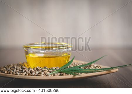 Hemp Oil Extracted In A Bowl Placed Near The Seeds And Leaves. Composition Of Extraction. Organic He