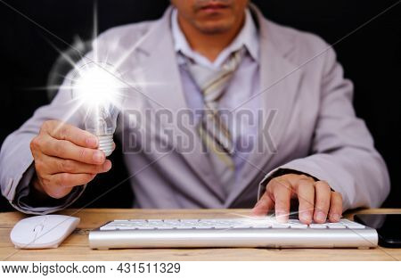 Idea Innovation And Inspiration Concept. Businessman Holding Illuminated Light Bulb, Concept Creativ