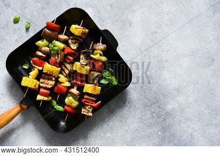 Vegetable Skewer On A Skewer In A Grill Pan On A Concrete Background. Vegetables To Grill In A Pan.