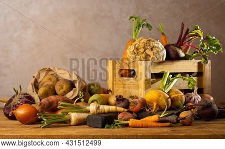 Autumn harvest of root vegetables. Still life of food on wooden table. Concept healthy food.