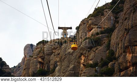 Yellow Cable Car In The Aeri De Montserrat Rise To De Montserrat Abbey Near Barcelona, Spain, Catalo