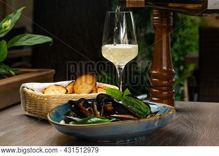Mussels In A Creamy Sauce With Croutons And A Glass Of Wine