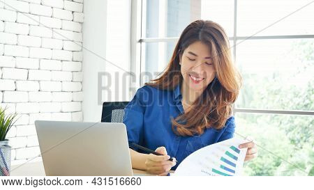 Happiness Asian Woman Working From Home Using Laptop Online Meeting In Home Office. Happy Relax Time