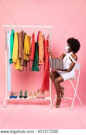 Black Shopaholic Lady Using Laptop Shopping Online, Pink Background, Vertical
