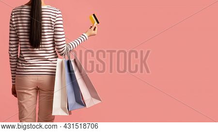 Easy Shopping. Young Female Holding Shopper Bags And Credit Card, Rear View