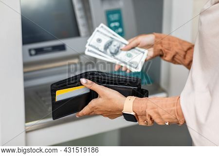 Young Arabian Female Got Dollars At Atm Machine, Folds Money In Wallet Outdoor, Cropped