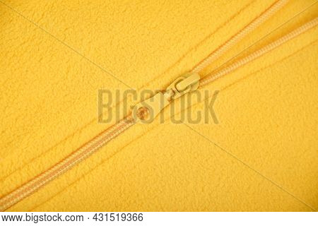 A Bright Detail Or A Pocket Of A Yellow Fleece Jacket With A Zipper For Autumn Or Winter As A Backgr