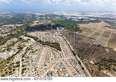 Drone Point Of View Countryside Meadows And Pinar De Campoverde Residential District View From Above