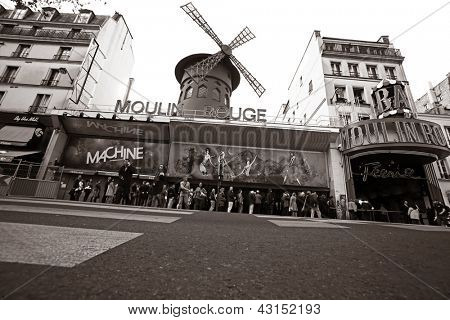 PARIS - MAY 08: The Moulin Rouge, on May 08, 2012 in Paris, France. Moulin Rouge is a famous cabaret built in 1889, locating in the Paris red-light district of Pigalle
