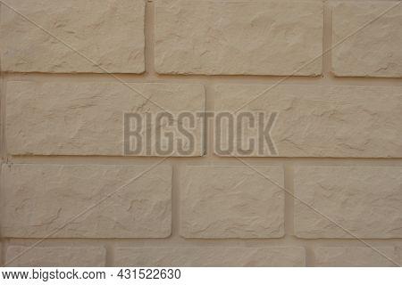 Close Shot Of Pale Yellow Brick Veneer Wall